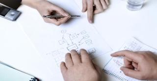 Advise-planning-hands-desk-notes-595x335